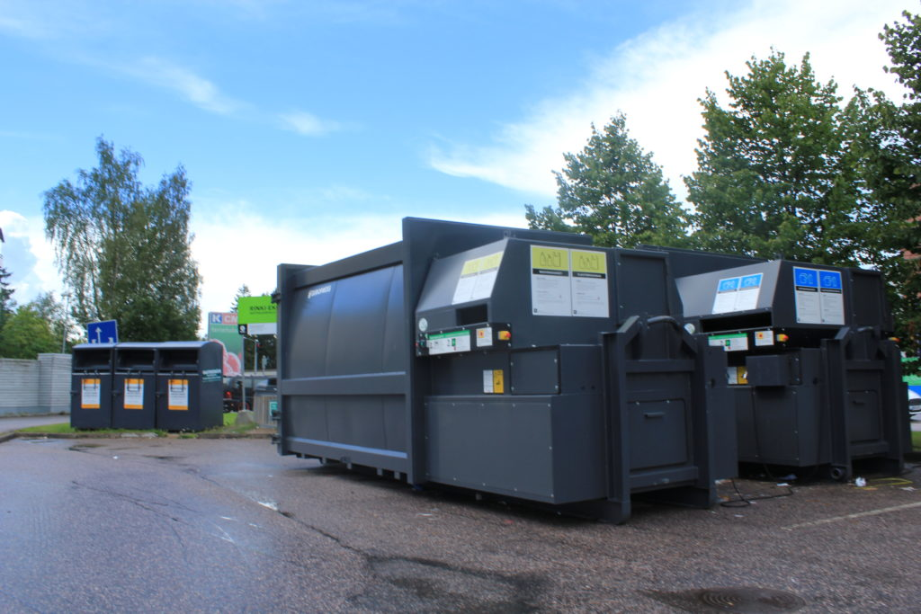 Waste compactors at public recycling point