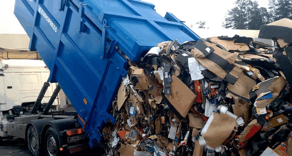 nousevakattoisen jätepuristimen tyhjennys